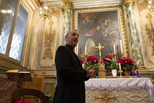 In this Monday, Dec. 9, 2019 photo, Monsignor John Kennedy, the head of the Congregation for the Doctrine of the Faith, walks through a chapel as he speaks during an interview at the Vatican. The Vatican office responsible for processing clergy sex abuse complaints has seen a record 1,000 cases reported from around the world this year, including from countries it had not heard from before, suggesting that the worst may be yet to come in a crisis that has plagued the Catholic Church. (AP Photo/Alessandra Tarantino)