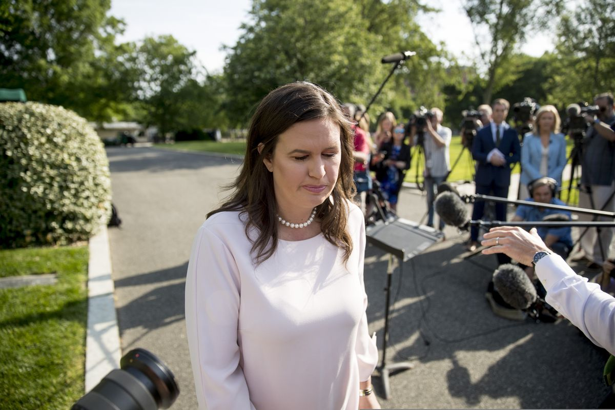 White House press secretary Sarah Huckabee Sanders walks towards the West Wing after speaking to reporters on the North Lawn at the White House in Washington, Thursday, May 23, 2019.(AP Photo/Andrew Harnik)