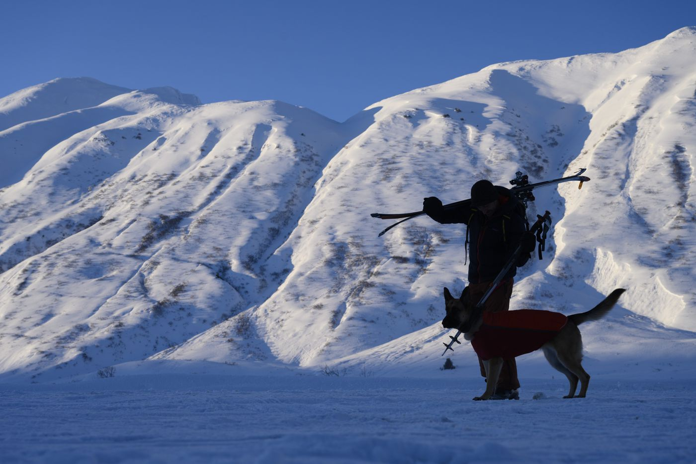 Jon Winiasz heads out for a ski at Turnagain Pass with Eva, his dog, on December 31, 2020. (Marc Lester / ADN)