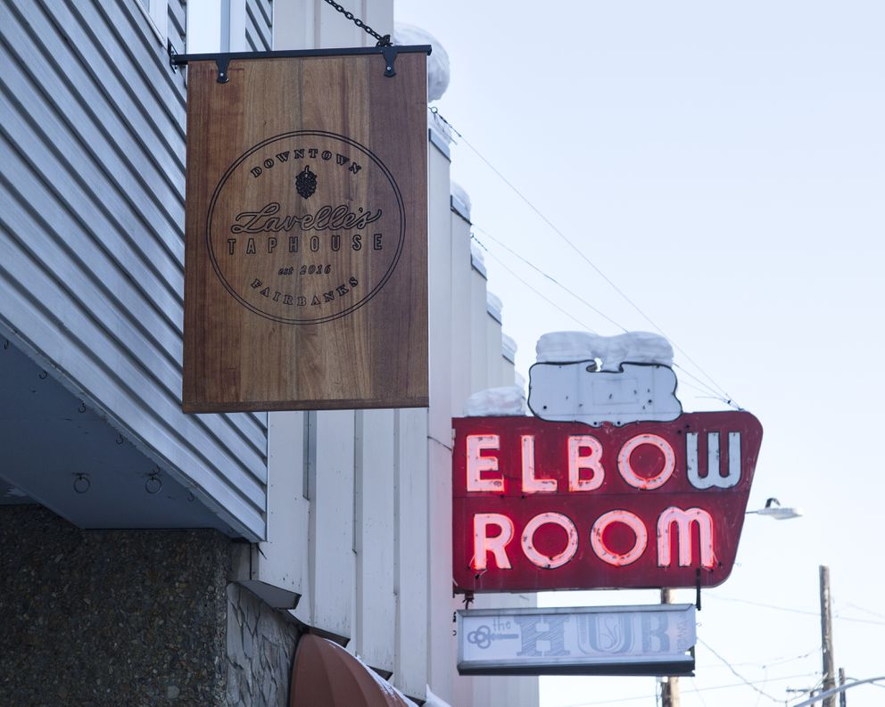 The Lavelle's Taphouse sign hangs near Tommy's Elbow Room, a bar that opened in 1947 and remained in business until 2003. The Elbow Room is now the site of a new shared workspace, the Hub. (Rugile Kaladyte / Alaska Dispatch News)