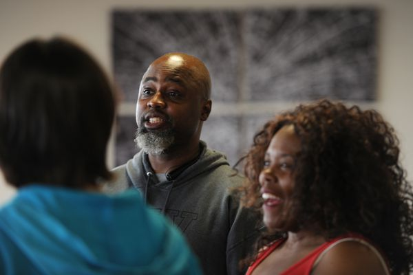 From left, Sonya Senkowsky, Darryl Akins and Corinthia Rabb-McCoy warm-up before a Mostly Melanin Arts improv troupe rehearsal at the Alaska Experience Theater in downtown Anchorage on Monday, April 2, 2018. (Bill Roth / ADN)
