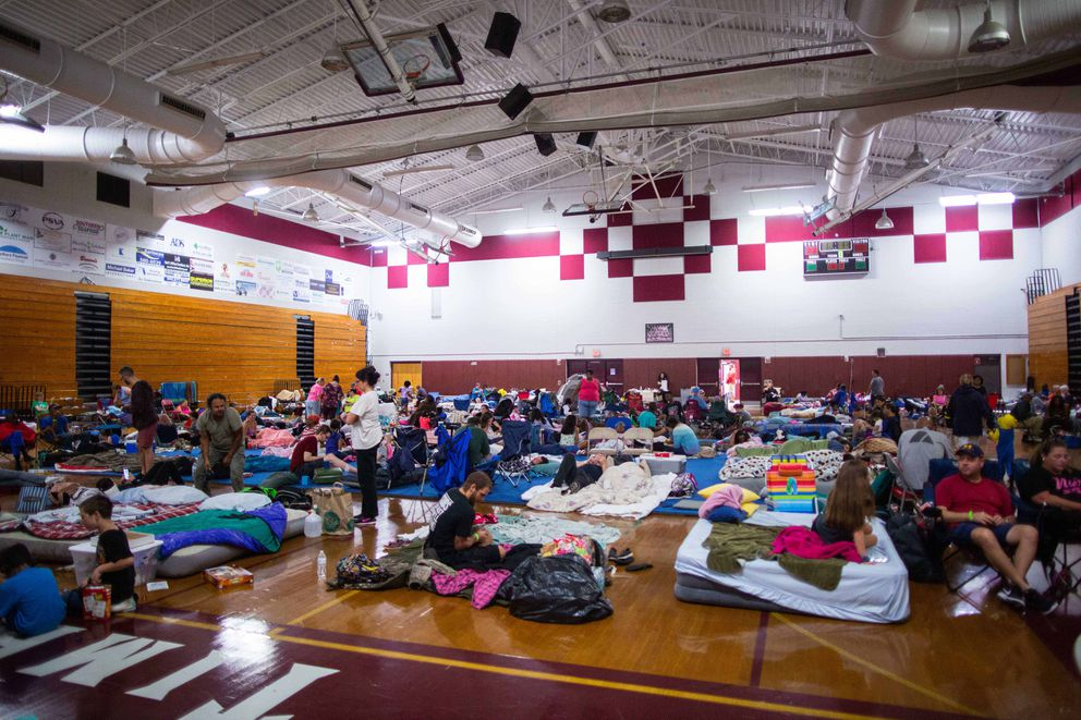 Evacuees wait out the storm at the Lawton Chiles High shelter on Tallahassee, Florida. Photo by Kevin D. Liles for The Washington Post
