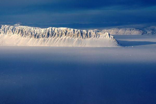 FILE PHOTO: Eureka Sound on Ellesmere Island in the Canadian Arctic is seen in a NASA Operation IceBridge survey picture taken March 25, 2014. NASA/Michael Studinger/Handout via REUTERS/File Photo ATTENTION EDITORS - THIS IMAGE WAS PROVIDED BY A THIRD PARTY. EDITORIAL USE ONLY.