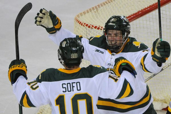 UAA sophomore left winger Joe Sofo, left, celebrates scoring the second goal of the game with sophomore right winger Trey deGraaf during the Seawolves' game winning goal during their 4-3 home victory over the Colorado College Tigers at the Sullivan Arena on Sunday, Oct. 7, 2018. (Bill Roth / ADN)