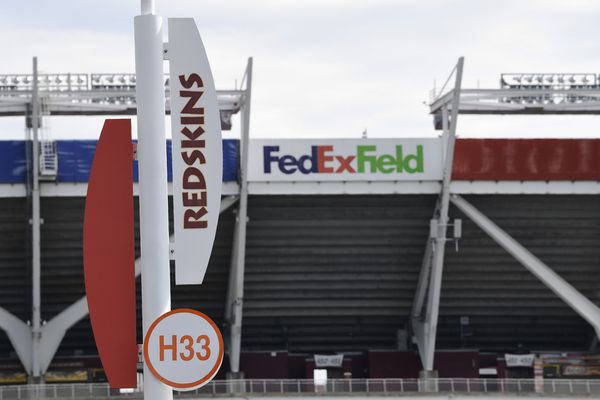 Signs for the Washington Redskins are displayed outside FedEx Field in Landover, Md., Monday, July 13, 2020. The Washington NFL franchise announced Monday that it will drop the