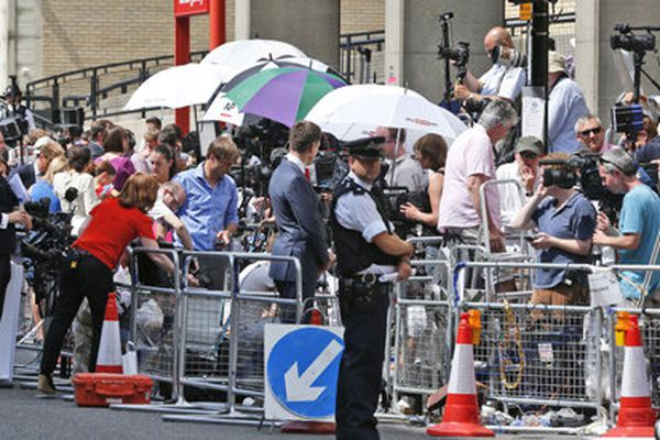 A British police officer, backdropped by members of the media, stands outside St. Mary's Hospital exclusive Lindo Wing in London. The press is eagerly awaiting the royal birth.