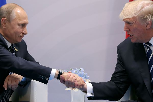 U.S. President Donald Trump shakes hands with Russian President Vladimir Putin during the their bilateral meeting at the G20 summit in Hamburg, Germany July 7, 2017. REUTERS/Carlos Barria TPX IMAGES OF THE DAY