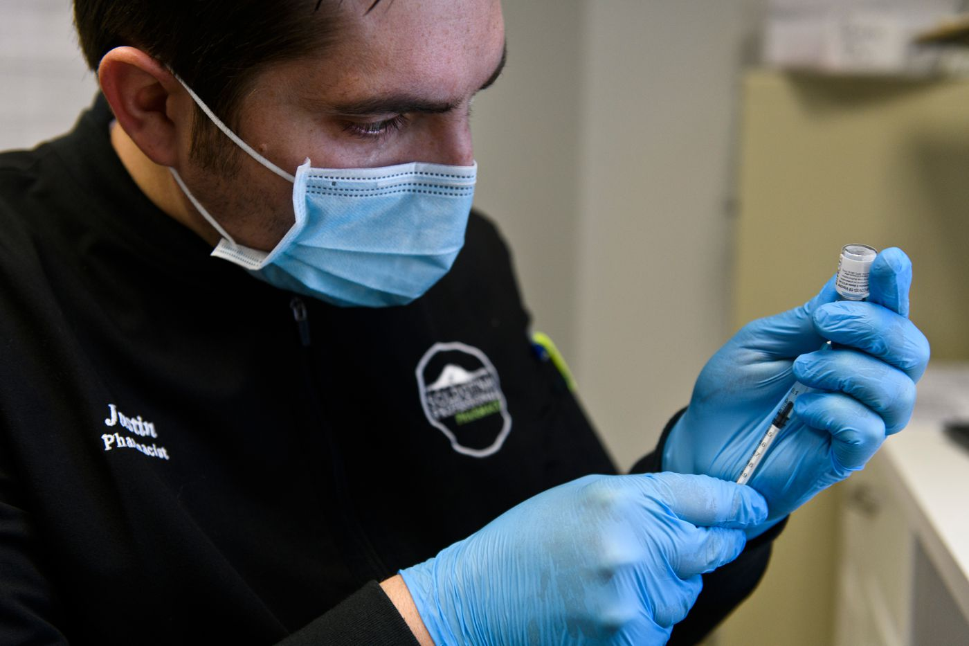 Pharmacist Justin Ruffridge fills a syringe with COVID-19 vaccine before giving and injection at Soldotna Professional Pharmacy on January 8, 2021. (Marc Lester / ADN)