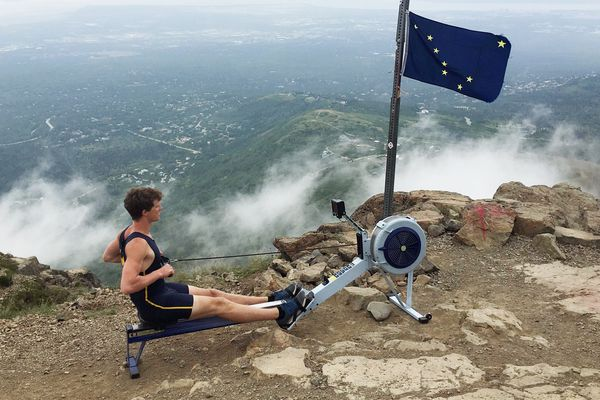 Jack Sexauer of Anchorage works out on a rowing machine he and Dan Tiggleman hauled up onto Flattop on Monday, July 24, 2017. Sexauer and Tiggleman, of Grand Rapid, Mi., rowed on the freshman 8 boat for the University of Michigan that placed fourth at the national championships in May, helping the men's team claim the overall points title..