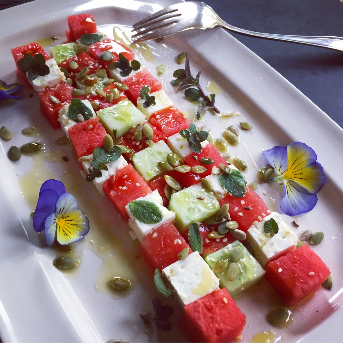 Watermelon-feta salad with pepitas and mint (Photo by Kim Sunée)