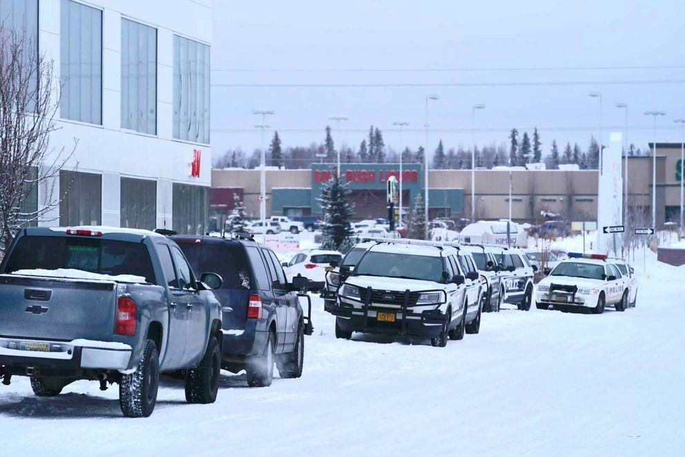 Anchorage police respond to a bomb threat at the Dimond Center on Tuesday. (Loren Holmes / ADN)
