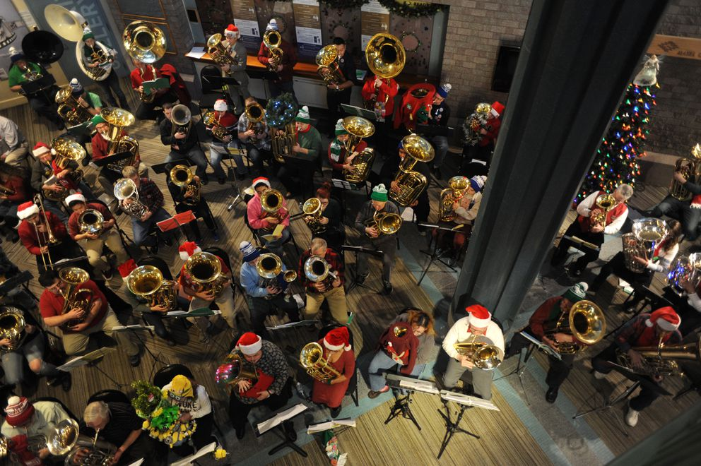 Over 60 musicians participated in the 20th annual TubaChristmas, a free hour-long community holiday event inside the lobby at the Alaska Center for the Performing Arts on Sunday, Dec. 13, 2015. The first TubaChristmas in Anchorage was held outdoors on the Town Square Park ice rink where their instruments kept freezing up before finding a home in the lobby. (Bill Roth / ADN)