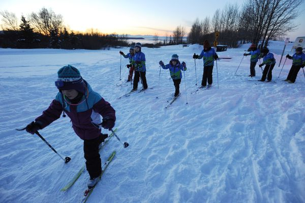 Lidia Driscoll, left, classic skis with other Polar Cub beginner skiers with the Anchorage Junior Nordic League at Kincaid Park on Wednesday evening, Feb. 28, 2018. (Bill Roth / ADN)