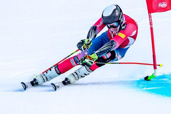 Alyeska Ski Club U16 Finnigan Donley dislodges a giant slalom gate with his ski pole near the finish line in the January 27, 2021 Coca-Cola Classic. (Photo by Bob Eastaugh)
