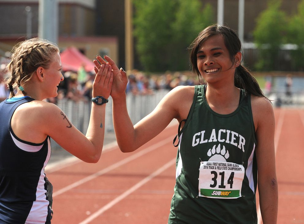 Ziza Shemet Pitcher of Homer and Ice Wangyot high-five after competing in the 200-meter sprint. (Bob Hallinen / Alaska Dispatch News)