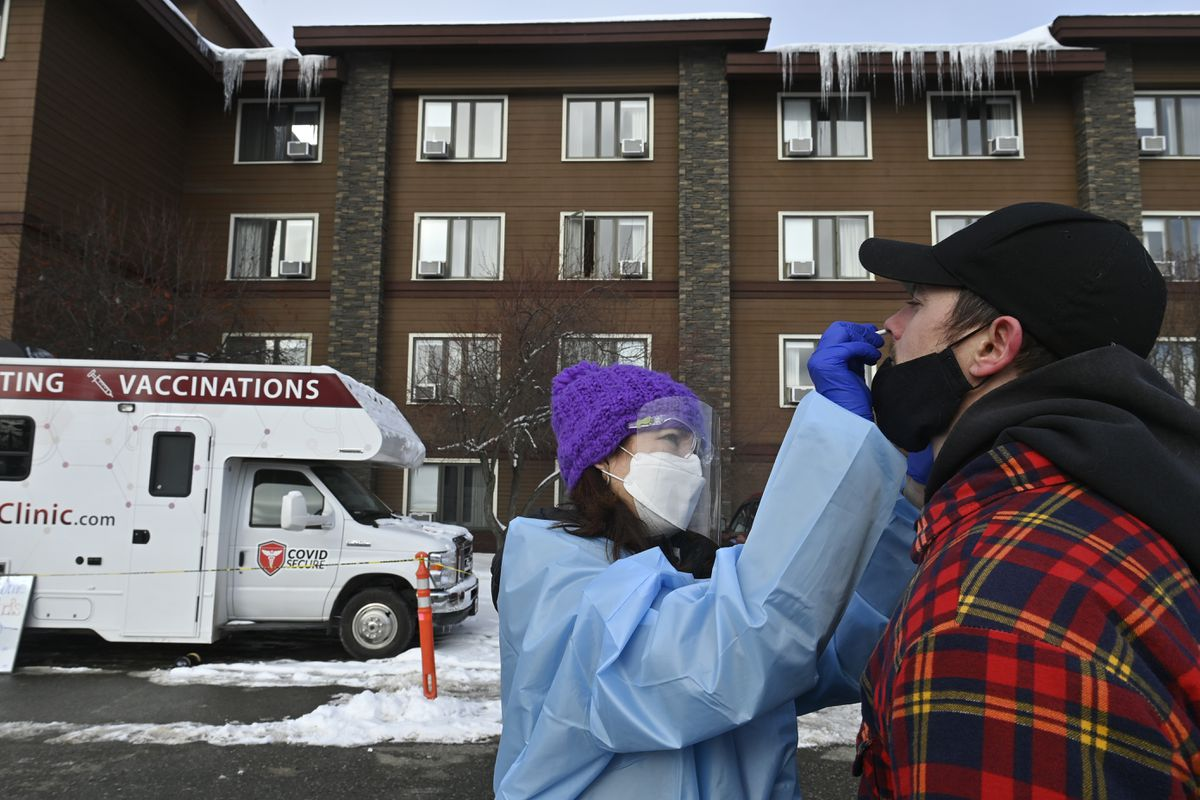 Dr. Jodie Guest tests Iditarod musher Matthew Failor for COVID-19 at a mobile clinic in front of Lakefront Hotel on March 3, 2021. Testing is required for Iditarod mushers before and during the race. (Marc Lester / ADN)