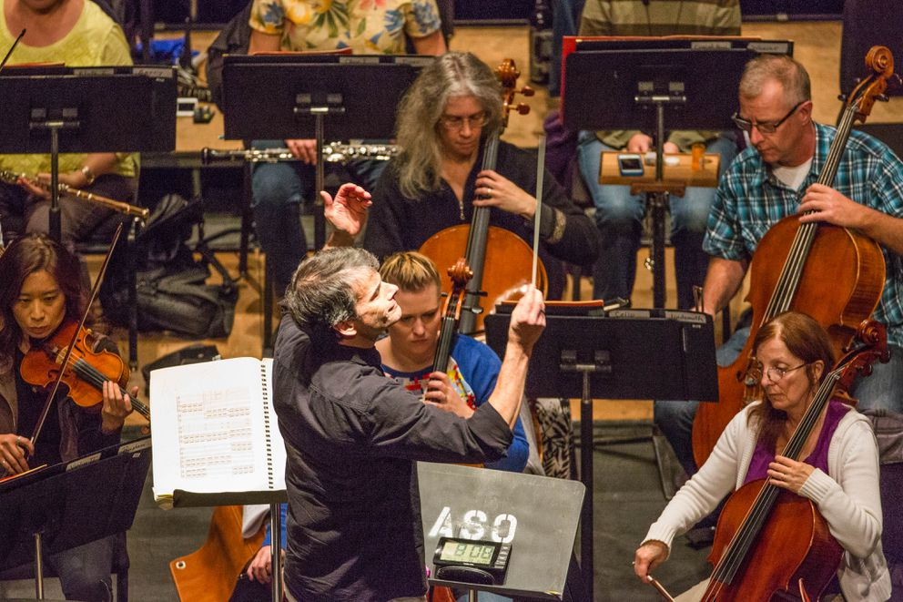 Anchorage Symphony Orchestra musical director and conductor Randall Craig Fleischer leads the orchestra during a rehearsal for their 70th season opening night performance, Wednesday, September 23, 2015 in the Atwood Concert Hall the Alaska Center for the Performing Arts.