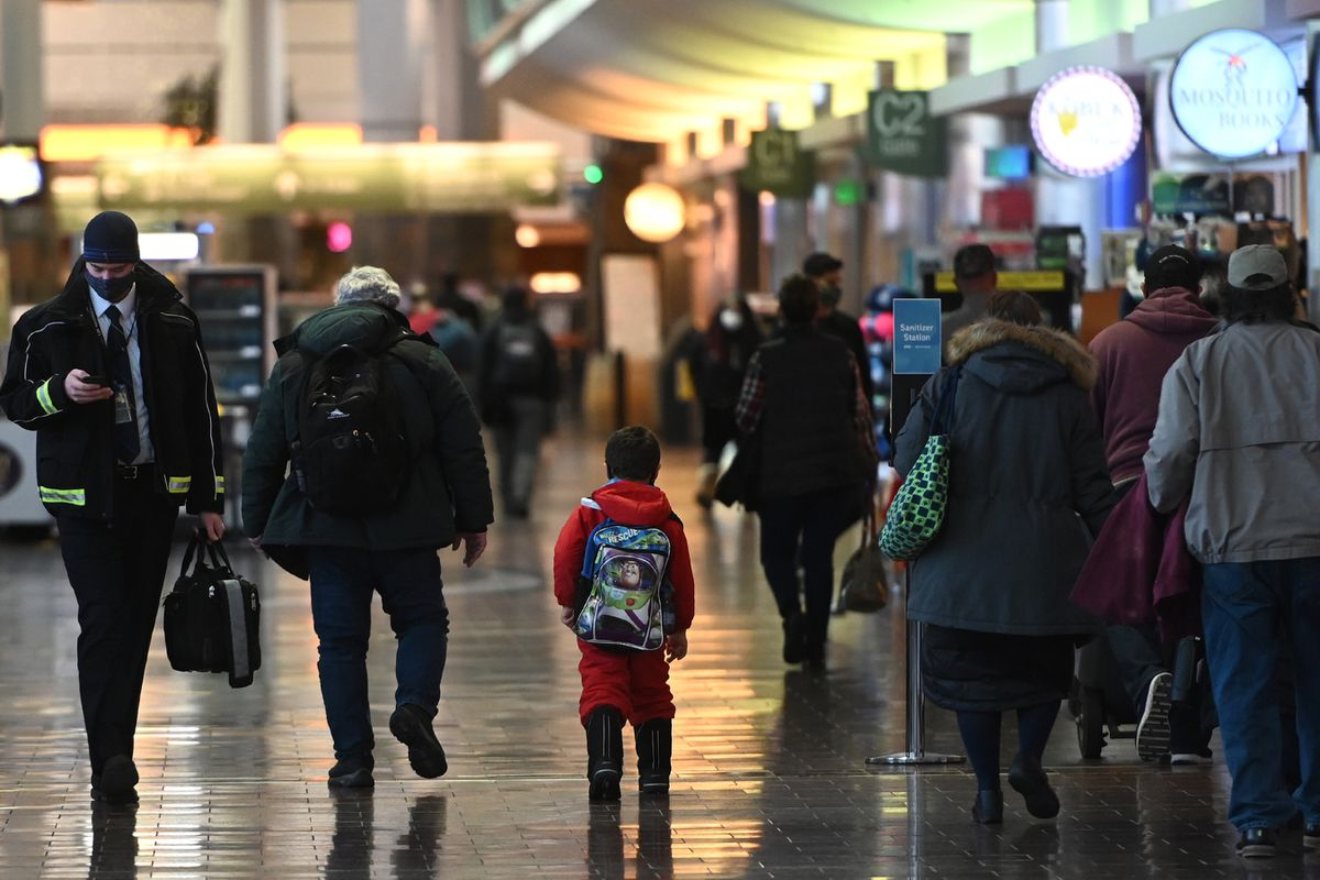Air travelers walk through Concourse C after arriving at Ted Stevens Anchorage International Airport on Thursday, Nov. 19, 2020. (Bill Roth / ADN)