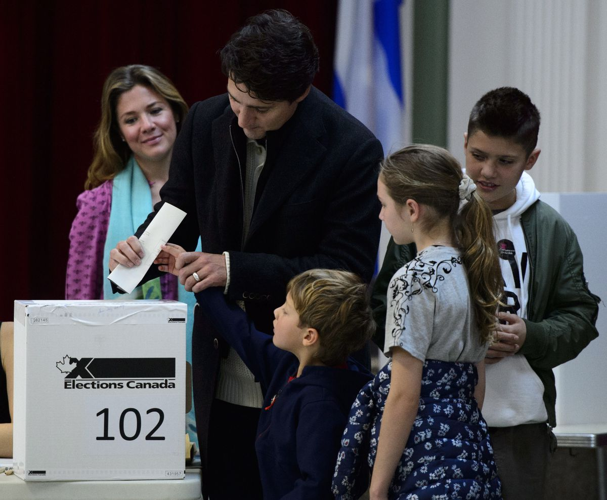 Canadian Prime Minister Justin Trudeau, second from left, votes with wife Sophie Gregoire-Trudeau, and children Xavier, Ella-Grace and Hadrien in Montreal, Monday, Oct. 21, 2019. Trudeau faced the threat of being knocked from power after one term as the nation held parliamentary elections on Monday. (Sean Kilpatrick/The Canadian Press via AP)