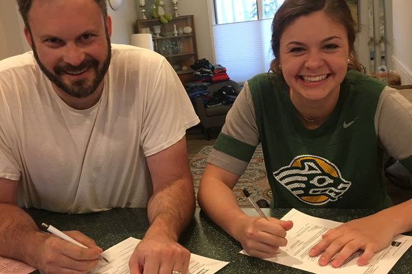 Jim Hajdukovich and his daughter Jahnna Hajdukovich smile as Jahnna prepares to sign her National Letter of Intent to play basketball at UAA on Tuesday. (Photo courtest of the Hajdukovich family)