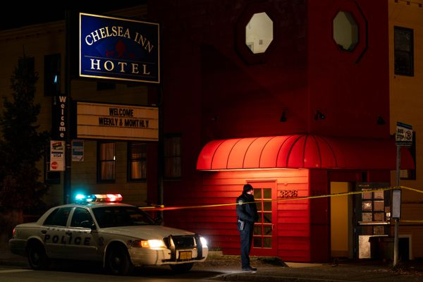Anchorage police investigate a homicide early Thursday morning, Oct. 22, 2020 at the Chelsea Inn Hotel in Spenard. According to a police statement, officers responded to a report of shots fired late Wednesday night and found a deceased man inside the hotel. (Loren Holmes / ADN)