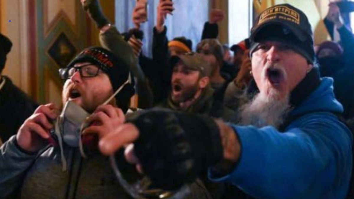 Indiana resident Jon Schaffer, right, is shown inside the U.S. Capitol Building during the Jan. 6, 2021, rioting, according to the FBI. He is now facing six federal criminal charges. (Tribune News Service)
