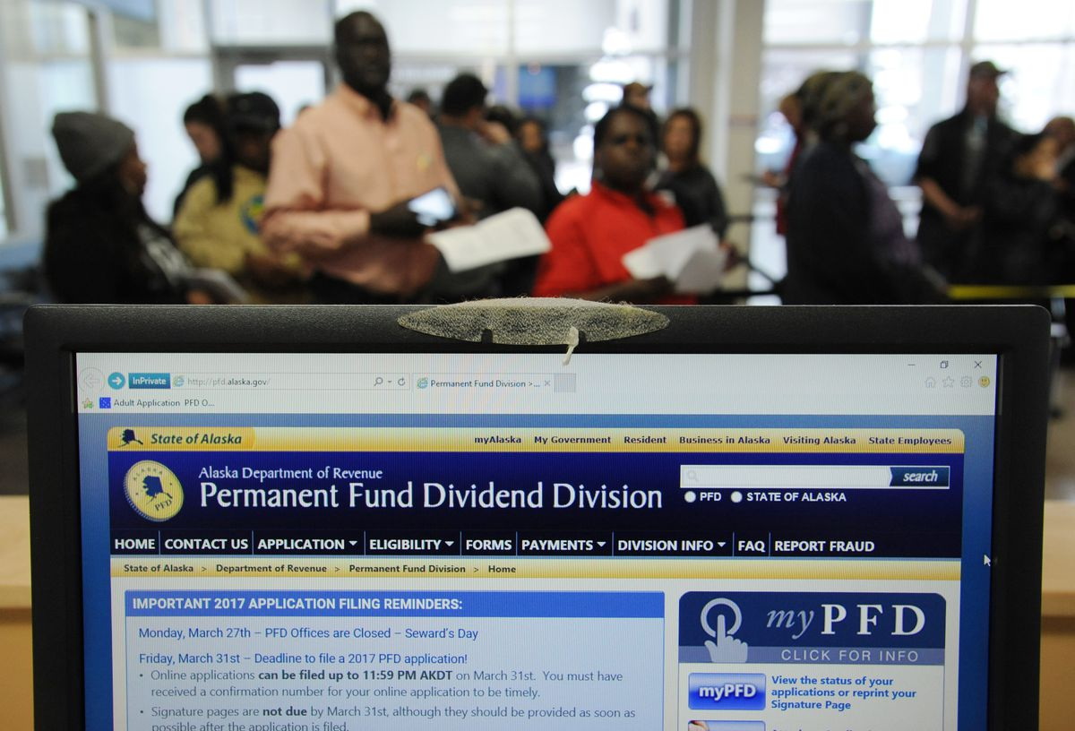 Alaska residents wait in line to file in-person for Alaska Permanent Fund Dividend on Thursday, March 30, 2017, at the PFD office in downtown Anchorage before the filing deadline on Friday. (Bill Roth / Alaska Dispatch News)