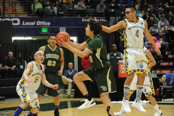 Robert Sheldon, of Noatak, goes for the basket as Chase Nay and Jacob Ahgook, of Nunamiut, defend in the championship game of the 1A boys Alaska State basketball tournament at the UAA Alaska Airlines Center in Anchorage, Alaska on Saturday, March 17, 2018. (Bob Hallinen / ADN)