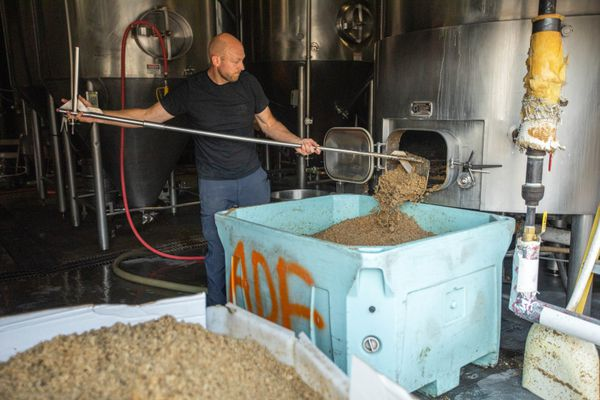 Midnight Sun brewer James Buckingham cleans a vessel Thursday, Aug. 29, 2019 at the Anchorage brewery. (Loren Holmes / ADN)
