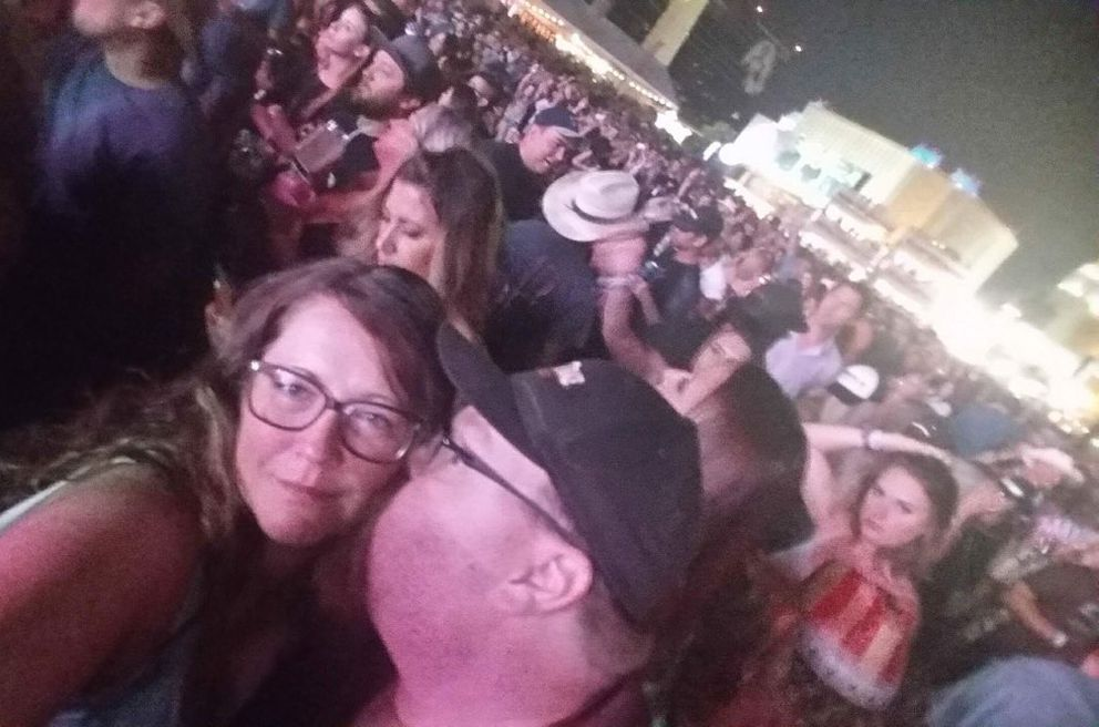 Chrissy Braniger gets a kiss from her husband, Erik Ross, at the Route 91 Harvest Festival country music concert in Las Vegas on Oct. 1, just before Jason Aldean's performance. (Photo by Chrissy Braniger)