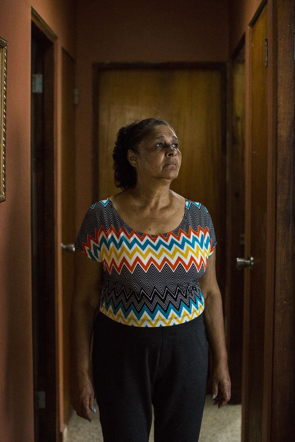 Norma Ramos' home has been without power for more than five months. Because of her husband's poor health, the two joined family members in the continental U.S. during the first months after the storm. But she decided to return and plans to stay in the island. (Photo for The Washington Post by Erika P. Rodriguez)