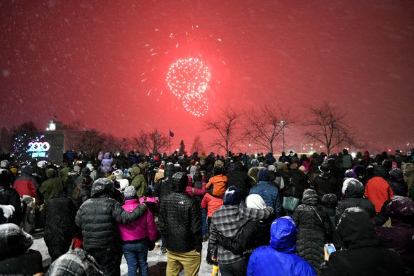 A crowd gathers to watch the fireworks show from downtown Anchorage. Anchorage Downtown Partnership hosted a New Year's Eve in a lot at 3rd Avenue and C Street featuring live music, dance performances and fireworks, on December 31, 2019. (Marc Lester / ADN)