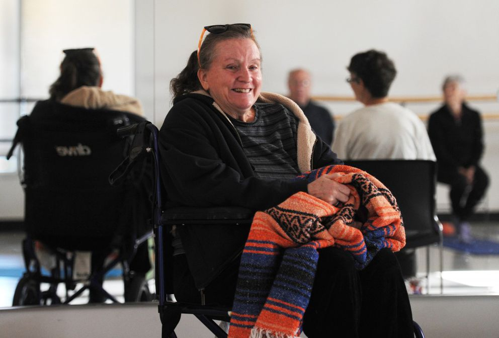 Sherri Hadley smiles as she enjoys the camaraderie of a weekly yoga session on Tuesday at Alaska Dance Theatre.(Erik Hill / Alaska Dispatch News)