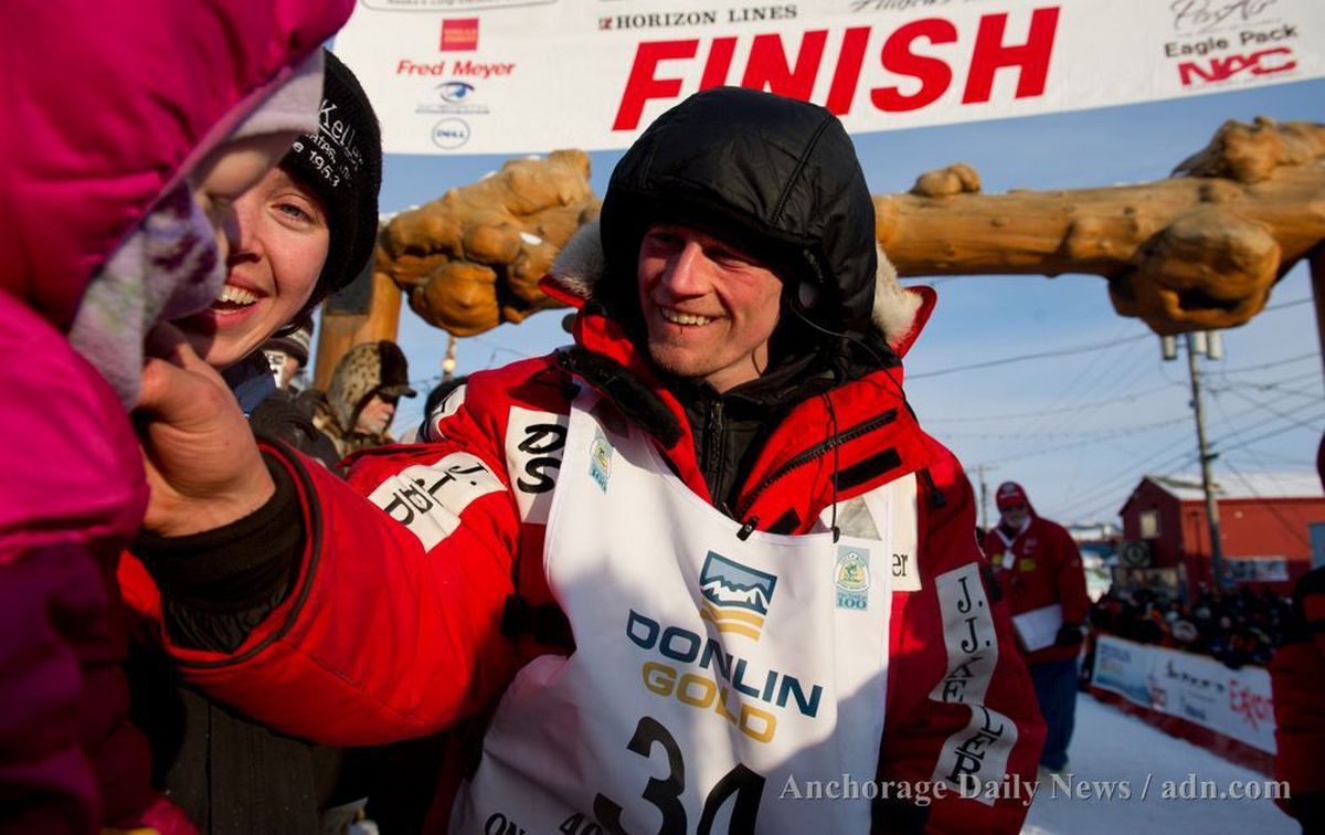 Dallas Seavey greets his daughter Annie and wife, Jen, under the burled arch. Seavey arrived at the finish line to claim victory in the Iditarod Trail Sled Dog Race in Nome on March 13, 2012. (Marc Lester / ADN archive 2012)