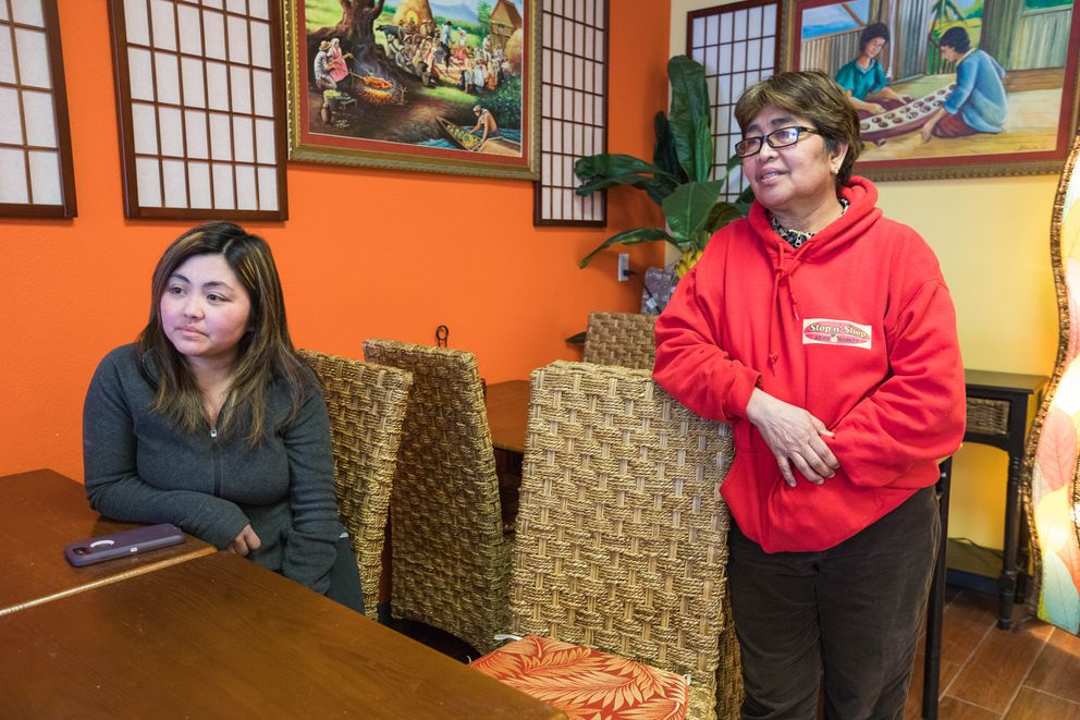 Betalyn Delacruz, owner of the Stop N' Shop Asian Market, and her mom, Marietta Morota, speak about the impact of volcano Mayon's eruption on their family that live near the mountain in the Philippines, on Wednesday. (Loren Holmes / ADN)