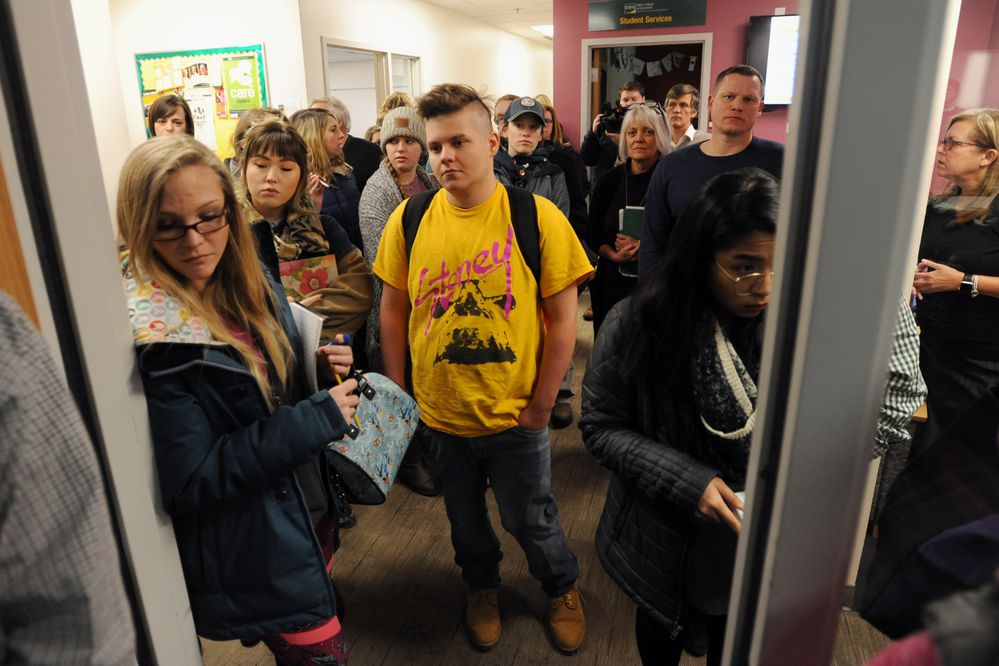 Students stand outside a classroom on Monday, Jan. 14, 2019, to hear University of Alaska Anchorage Chancellor Cathy Sandeen and UAA School of Education interim director Claudia Dybdahl speak about the School of Education's loss of accreditation for its initial licensure programs. (Bill Roth/ ADN)
