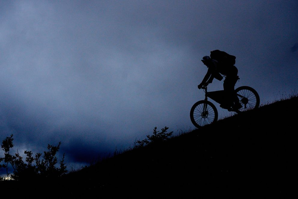 Luc Mehl descends one of the Nulato Hills late at night. (Eric Parsons)