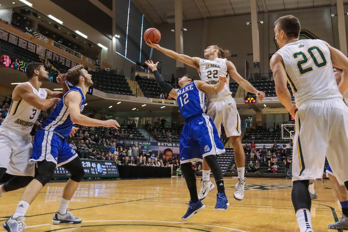 UAA's Sjur Berg (22) catches a rebound during a 2016 Great Alaska Shootout game against Drake. (Loren Holmes / ADN arhives)
