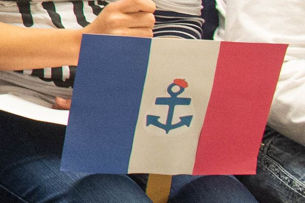 The logo for French Language Advocates Anchorage, a local nonprofit that submitted the proposal to start a new French language immersion program in the Anchorage School District. The anchor represents Anchorage. The nonprofit is focused on building a French speaking community in Anchorage through events, meetups and the new immersion program. Photographed at an Anchorage School Board meeting November 5, 2018. (Marc Lester / ADN)