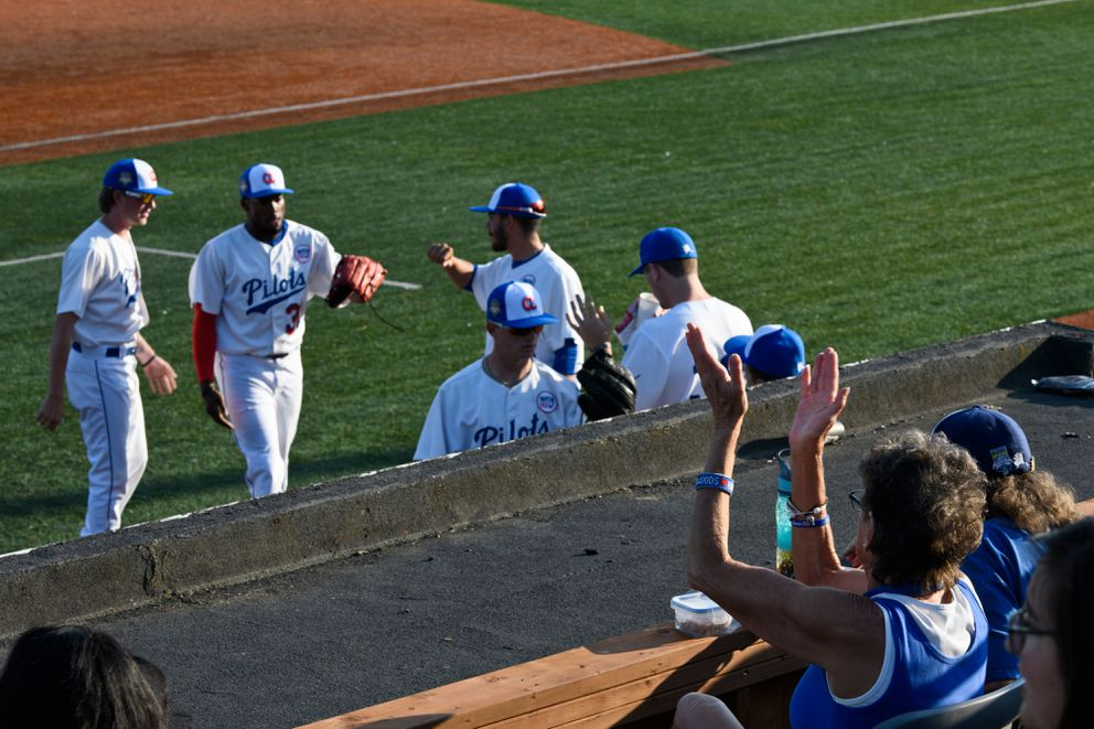 A fan applauds as the Pilots return to their dugout after an inning in the field. (Marc Lester / ADN)