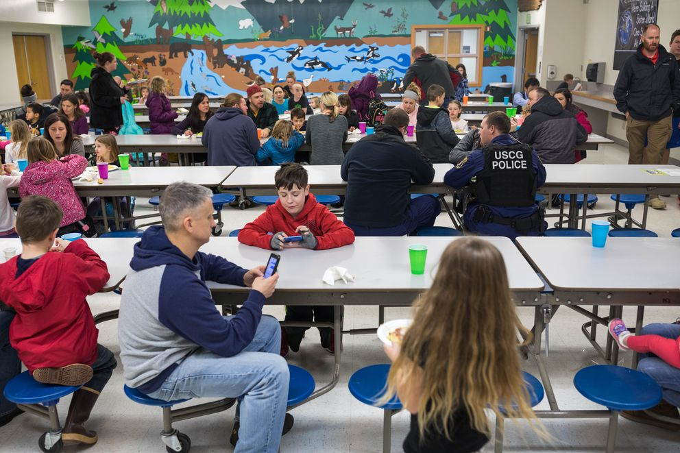 People eat at a free spaghetti meal at Peterson Elementary School on Thursday, Jan. 24, 2019. The Kodiak community organized the event to help federal employees affected by the partial government shutdown. (Loren Holmes / ADN)