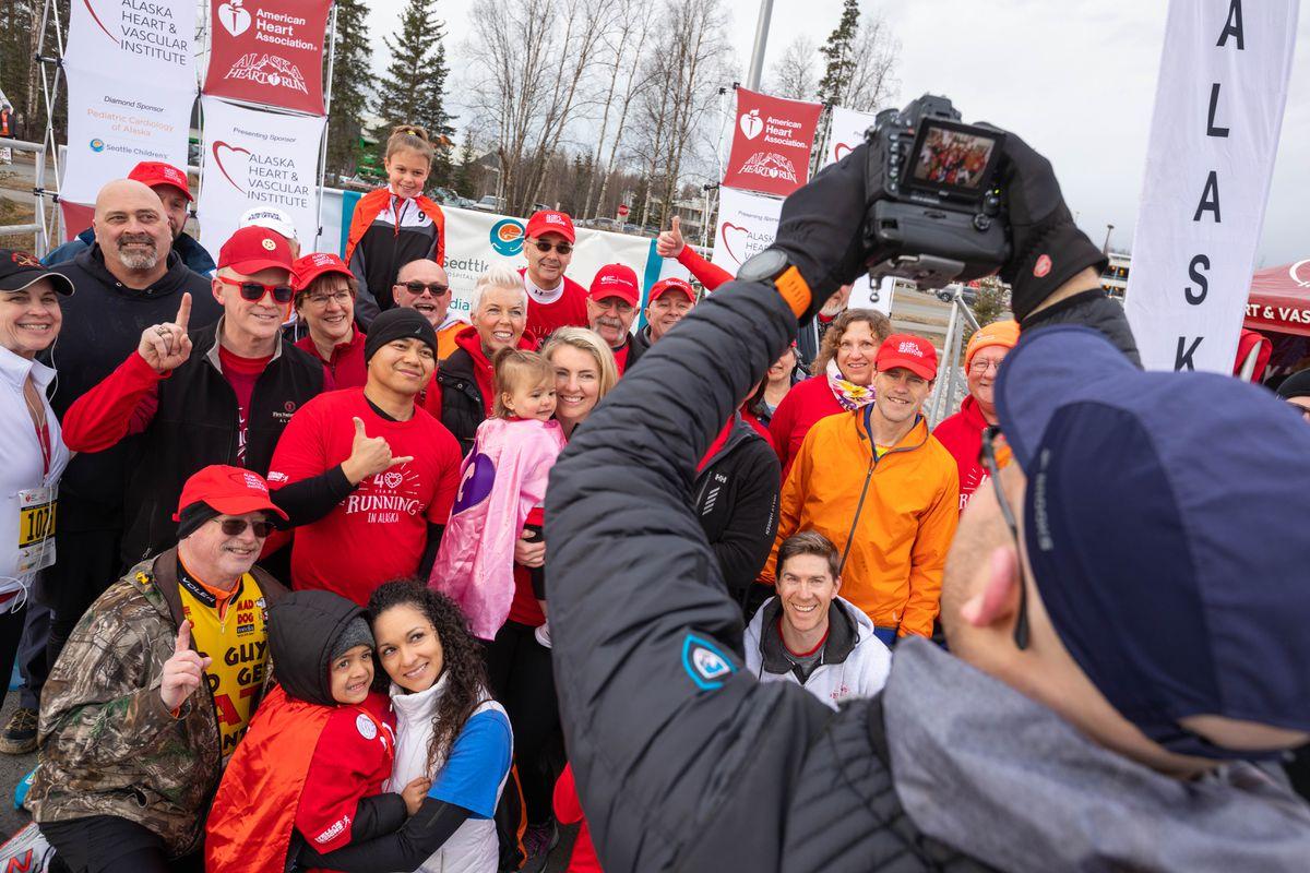 Matthew Waliszek photographs heart disease survivors before the start of last year's Heart Run. (Loren Holmes / ADN)