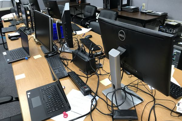 Mat-Su Borough computers in the process of being cleaned and re-imaged by a contractor on Monday, July 30, 2018. (Bill Roth / ADN)