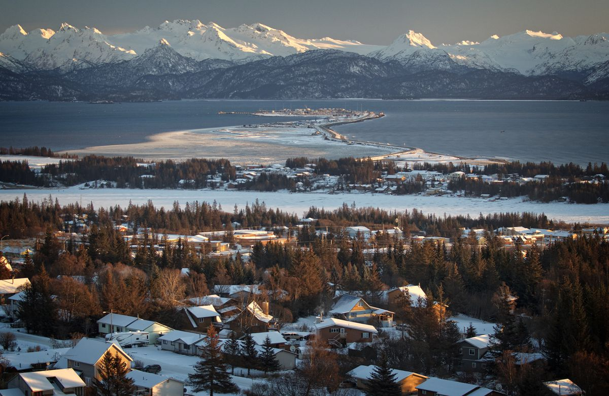 The town of Homer, Alaska, sits on the edge of stunning Kachemak Bay and ringed by the Kenai Mountains. The Homer Spit, a geologic landform, extends out 4.5 miles into the Bay, almost halfway across to its south side. (Jim Lavrakas / Far North Photography)