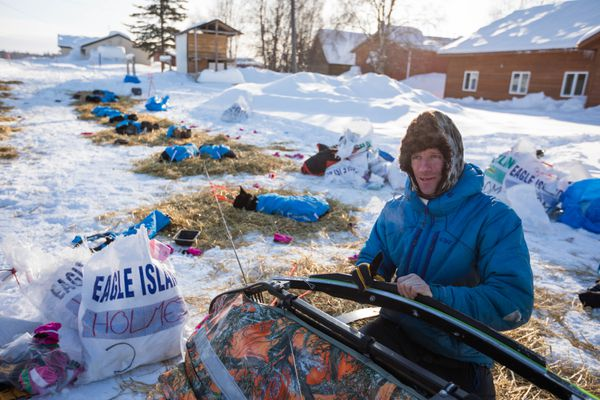 Jessie Holmes fixes the runners on his sled Saturday, March 10, 2018 in Grayling. (Loren Holmes / ADN)