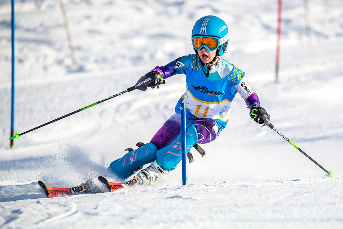 Madison Allard basks in rare sun on the Tanaka Hill course in the second of two Alyeska Cup slalom races Monday. (Photo by Bob Eastaugh)