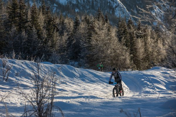 Racers bike through the trails at Eagle River Nature Center during the Icy River Rampage 20-mile fat tire bike race Saturday, Feb. 4, 2017. (Loren Holmes / Alaska Dispatch News)