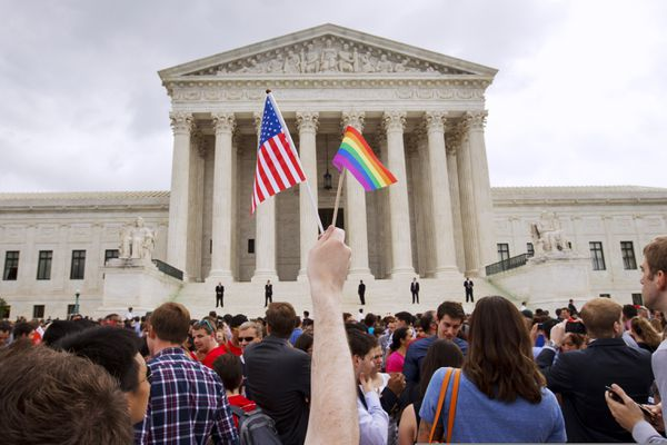FILE - In this June 26, 2015, file photo, a crowd celebrates outside of the Supreme Court in Washington after the court declared that same-sex couples have a right to marry anywhere in the U.S. (AP Photo/Jacquelyn Martin, File)