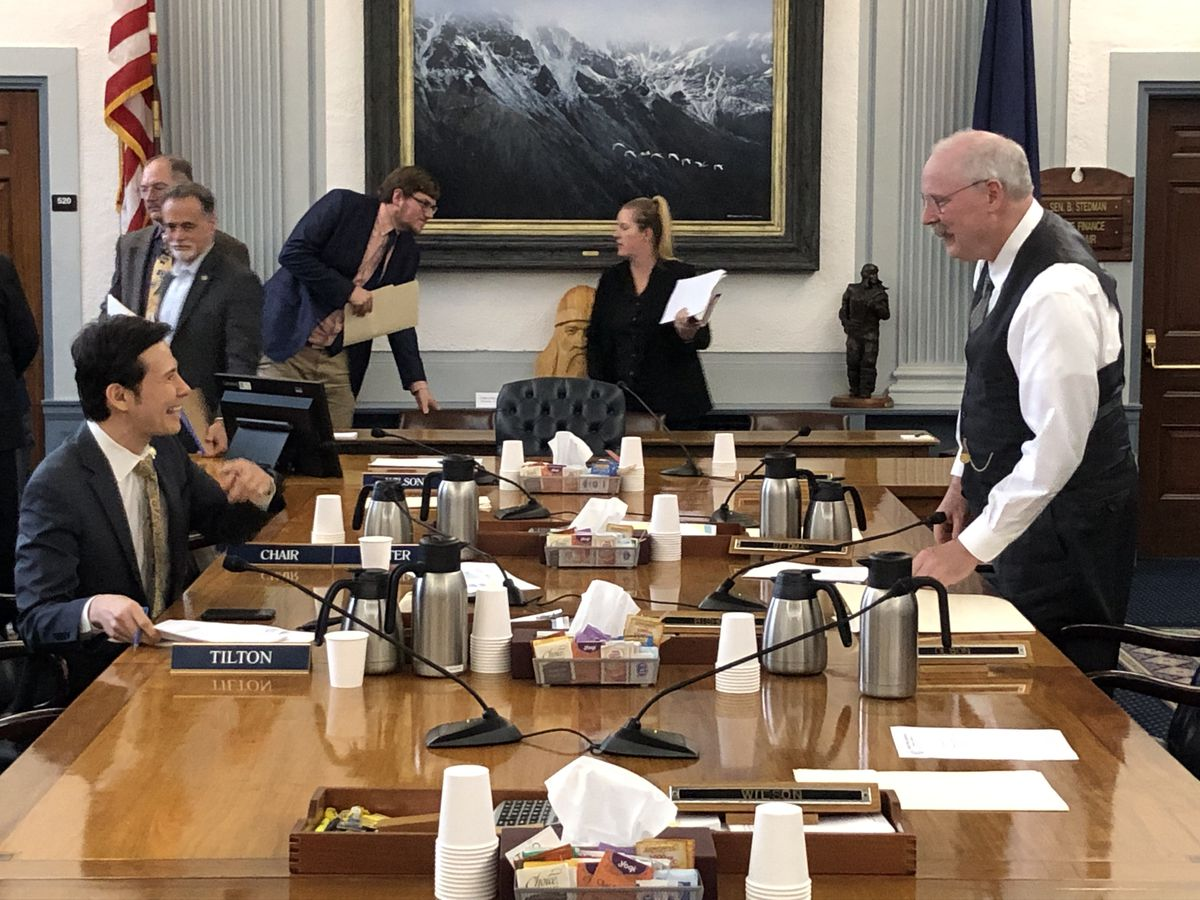 Rep. Neal Foster, D-Nome, left, talks with Sen. Bert Stedman, R-Sitka, right, after both men helped reach a House-Senate compromise on Alaska's state operating budget Saturday, June 8, 2019. (James Brooks / ADN)