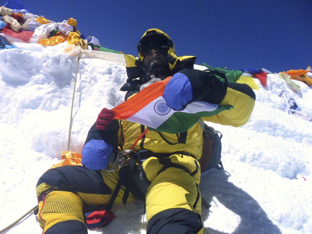 In a handout photo, Subhas Paul at the summit of Mount Everest. Paul died on his way down from the summit. (Subhas Paul via The New York Times)